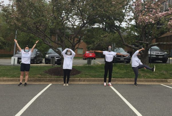 The spring 2021 field team spell out VOTE with their bodies